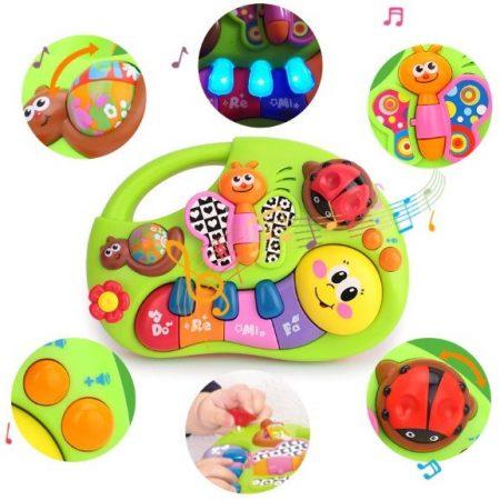 Zenélő baba játék Hola