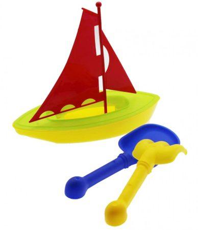 Strand játék vitorláshajóval lapáttal, és gereblyével